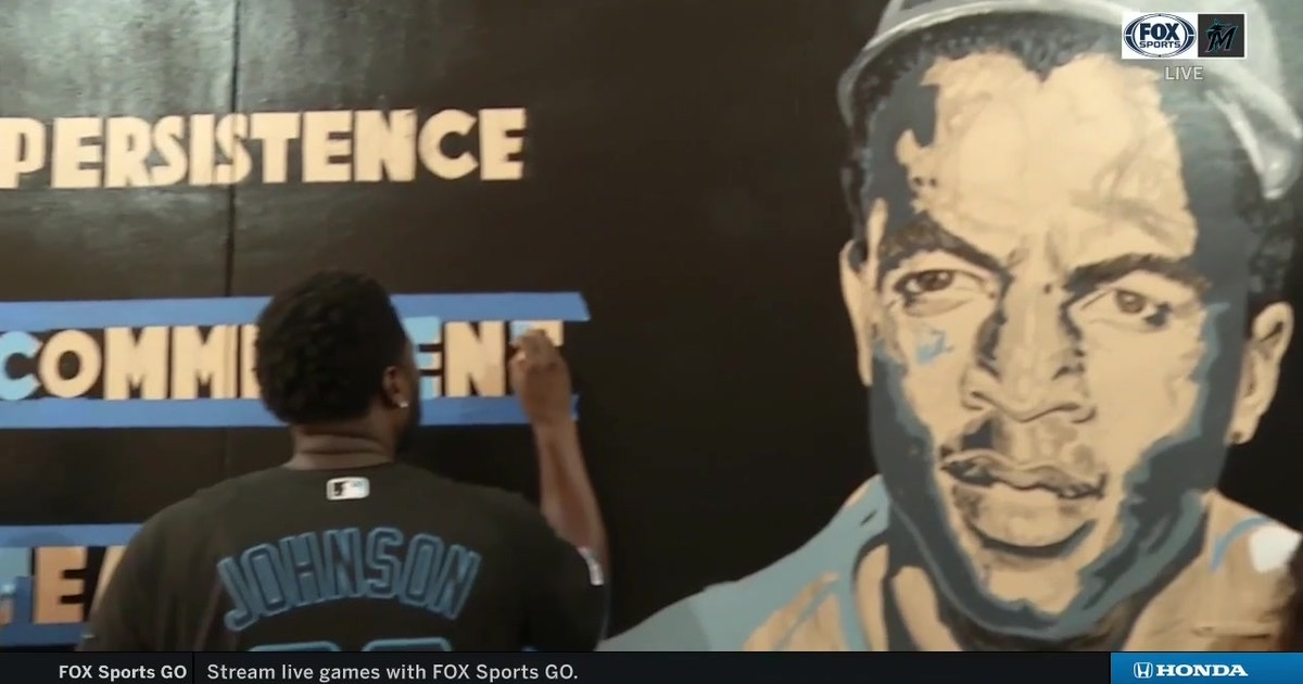Marlins continue Impact Week with Beautification Project that included the painting of Jackie Robinson-themed mural