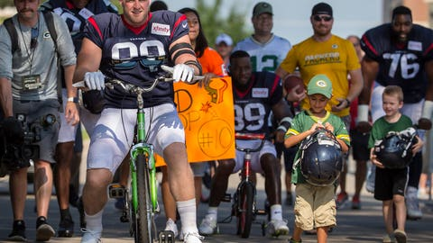 <p>               Houston Texans' J.J. Watt rides a bike to a joint NFL football practice between the Texans and the Green Bay Packers Monday, Aug 5, 2019, in Green Bay, Wis. (AP Photo/Mike Roemer)             </p>
