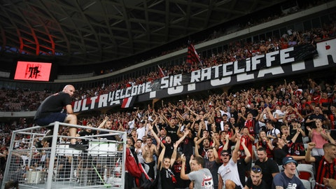 "<p>               Nice soccer fans cheer for Bob Ratcliffe under a banner that reads ""Welcome Sir Ratcliffe"" before the start of the French League One soccer match between Nice and Marseille at the Allianz Riviera stadium in Nice, southern France, Wednesday, Aug. 28, 2019. (AP Photo/Daniel Cole)             </p>"