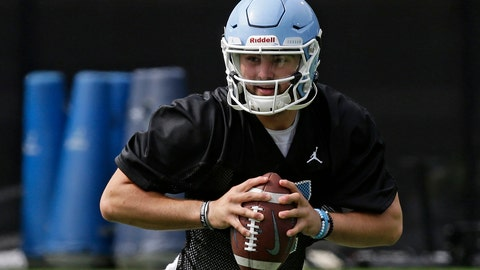 <p>               FILE - In this Aug. 2, 2019, file photo, North Carolina quarterback Sam Howell (7) is shown during an NCAA college football practice in Chapel Hill, N.C. North Carolina is starting true freshman Sam Howell at quarterback for Saturday's opener against South Carolina in Charlotte. (AP Photo/Gerry Broome, File)             </p>
