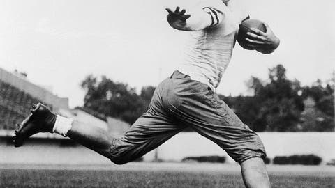 <p>               FILE - In this 1934 file photo, University of Chicago halfback Jay Berwanger is shown in the action pose that served as the model for the Heisman Trophy. In the early days of the NFL, college football was king and playing the game professionally was not necessarily something players aspired to do. (AP Photo/File)             </p>