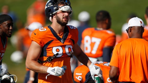 <p>               Denver Broncos tight end Jake Butt grabs a water bottle during a combined NFL training camp with the San Francisco 49ers Saturday, Aug. 17, 2019, at the Broncos' headquarters in Englewood, Colo. (AP Photo/David Zalubowski)             </p>