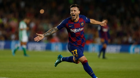 <p>               FC Barcelona's Carles Perez celebrates after scoring his side's third goal during the Spanish La Liga soccer match between FC Barcelona and Betis at the Camp Nou stadium in Barcelona, Spain, Sunday, Aug. 25, 2019. (AP Photo/Joan Monfort)             </p>