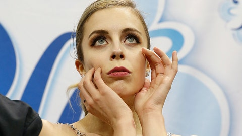 """<p>               FILE - In this Jan. 5, 2018, file photo, Ashley Wagner waits for her scores during the women's free skate event at the U.S. Figure Skating Championships in San Jose, Calif. Former Olympian Ashley Wagner says she was sexually assaulted by another figure skater in 2008 when she 17. The three-time national champion writes in USA Today on Thursday, Aug. 1, 2019, that John Coughlin climbed into her bed after a party at a skating camp and began kissing and groping her. Coughlin was 22 at the time and took his life in January at 33. Wagner says she was """"absolutely paralyzed in fear."""" (AP Photo/Tony Avelar, File)             </p>"""