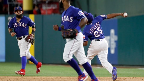 <p>               Texas Rangers' Rougned Odor, rear, and Danny Santana, front, jog to join the team in celebration as relief pitcher Jose Leclerc throws a ball following the team's 5-4 win against the Detroit Tigers in a baseball game in Arlington, Texas, Friday, Aug. 2, 2019. Leclerc threw the ball after covering first for the final out of the game. (AP Photo/Tony Gutierrez)             </p>