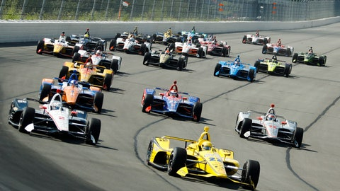 <p>               Drivers led by Simon Pagenaud (22) enter Turn 1 after taking the green flag to start the IndyCar Series auto race at Pocono Raceway, Sunday, Aug. 18, 2019, in Long Pond, Pa. (AP Photo/Matt Slocum)             </p>