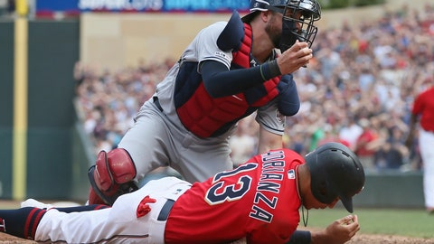 <p>               Cleveland Indians catcher Kevin Plawecki, left,  tags out Minnesota Twins' Ehire Adrianza, right, as he tried to score from first base on a double by Marwin Gonzalez in the ninth inning of a baseball game Sunday, Aug. 11, 2019, in Minneapolis. The Indians won 7-3 in 10 innings. (AP Photo/Jim Mone)             </p>