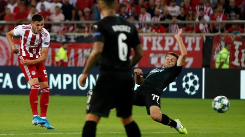 <p>               Olympiakos' Lazar Randelovic, left, scores his side's third goal during the Champions League qualifying playoff first leg soccer match between Olympiakos and Krasnodar at Georgios Karaiskakis stadium in Piraeus port, near Athens, Wednesday, Aug. 21, 2019. (AP Photo/Thanassis Stavrakis)             </p>