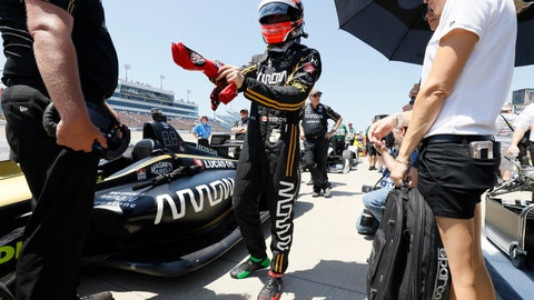 <p>               FILE - In this July 19, 2019, file photo, James Hinchcliffe stands next to his car during qualifying for the IndyCar Series auto race at Iowa Speedway in Newton, Iowa. McLaren will return to full-time IndyCar competition next season for the first time since 1979 in a partnership with existing team Arrow Schmidt Peterson Motorsports. The new venture will be renamed Arrow McLaren Racing SP and rely on Arrow SPM's current infrastructure.(AP Photo/Charlie Neibergall, File)             </p>