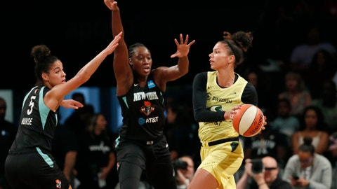 <p>               Seattle Storm forward Alysha Clark, right, passes as New York Liberty guard Kia Nurse, left, and center Tina Charles,center, defend during the first half of a WNBA basketball game, Sunday, Aug. 11, 2019, in New York. (AP Photo/Kathy Willens)             </p>
