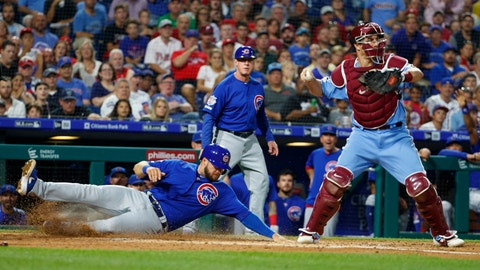 <p>               Chicago Cubs' David Bote, left, slides into home on the hit by Albert Almora Jr. as Philadelphia Phillies catcher J.T. Realmuto, right, looks to throw the ball to second during the fourth inning of a baseball game, Thursday, Aug. 15, 2019, in Philadelphia. (AP Photo/Chris Szagola)             </p>