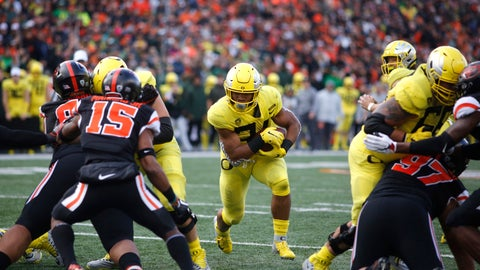 <p>               FILE - In this Friday, Nov. 23, 2018 file photo ,Oregon running back C.J. Verdell, center, and Oregon State safety Jeffrey Manning Jr. (15) during an NCAA college football game in Corvallis, Ore. College football starts better than it ends. The sport has evolved through numerous postseason systems that have clumsily crowned champions, and while the College Football Playoff does a better job than its predecessors it has also spawned a month's worth of tedious debate over the meaningfulness of bowl games. (AP Photo/Timothy J. Gonzalez, File)             </p>