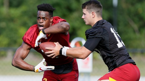 <p>               FILE - In this Aug. 2, 2019, file photo, Iowa State quarterback Brock Purdy hands the ball off to running back Kene Nwangwu, left, during an NCAA college football practice in Ames, Iowa. The Cyclones' search to replace departed star David Montgomery has been the dominant story line of fall camp, with senior Sheldon Croney, Jr., junior Kene Nwangwu, sophomore Johnnie Lang and freshmen Jirehl Brock and Breece Hall all competing for playing time starting with the opener on August 31 against Northern Iowa.(AP Photo/Charlie Neibergall, File)             </p>