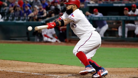 <p>               Texas Rangers' Rougned Odor (12) bunts on a pitch from Seattle Mariners' Taylor Guilbeau in the seventh inning of a baseball game in Arlington, Texas, Saturday Aug. 31, 2019. Odor was out at first on the attempt. (AP Photo/Tony Gutierrez)             </p>