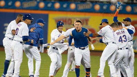 <p>               New York Mets' J.D. Davis reacts, center, is congratulated by teammates after he drove in the winning run with a single during the 10th inning of the team's baseball game against the Cleveland Indians, Wednesday, Aug. 21, 2019, in New York. The Mets won 4-3. (AP Photo/Mary Altaffer)             </p>
