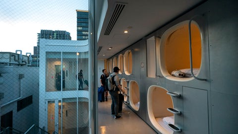 <p>               In this May 30, 2019, photo, a group of American tourists walk toward their pods after checking in at 9H capsule hotel at Chiyoda district of Tokyo. Tokyo is shaping up as a very pricey Olympics. Ticket demand is unprecedented, so scalping is sure to flourish. Hotel rates are soaring to five-six times normal. And getting here will be costly, particularly for fans from the Americas and Europe. (AP Photo/Jae C. Hong)             </p>