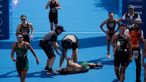 <p>               Mexico's Cecilia Perez, center, collapses after competing in a women's triathlon test event at Odaiba Marine Park, a venue for marathon swimming and triathlon at the Tokyo 2020 Olympics, Thursday, Aug. 15, 2019, in Tokyo. Tokyo's summer heat has forced an Olympic women's triathlon qualifying event to be shortened because of high temperatures that are likely to plague next year's games. (AP Photo/Jae C. Hong)             </p>