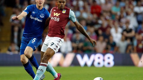 <p>               Aston Villa's Wesley, right, and Everton's Michael Keane run for the ball during the English Premier League soccer match between Aston Villa and Everton at Villa Park in Birmingham, England, Friday, Aug. 23, 2019. (AP Photo/Rui Vieira)             </p>