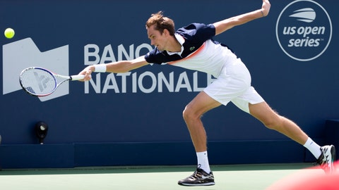 <p>               Daniil Medvedev, of Russia, reaches out for the ball in his match against Dominic Thiem, of Austria,  during quarterfinal play at the Rogers Cup tennis tournament in Montreal, Friday, Aug. 9, 2019. (Paul Chiasson/The Canadian Press via AP)             </p>