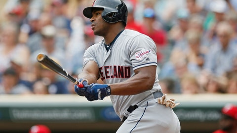 <p>               Cleveland Indians' Yasiel Puig hits an RBI double off Minnesota Twins pitcher Jose Berrios in the first inning of a baseball game Sunday, Aug. 11, 2019, in Minneapolis. (AP Photo/Jim Mone)             </p>