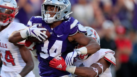 <p>               Kansas State running back James Gilbert (34) makes it to the end zone for a touchdown, before being tackled by Nicholls State linebacker Allen Pittman (47) during the first half of an NCAA college football game in Manhattan, Kan., Saturday, Aug. 31, 2019. (AP Photo/Orlin Wagner)             </p>