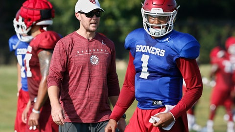 <p>               FILE - In this Monday, Aug. 5, 2019 file photo, Oklahoma head coach Lincoln Riley watches quarterback Jalen Hurts (1) during an NCAA college football practice in Norman, Okla. Oklahoma quarterback Jalen Hurts is cramming as he prepares for his only year with the Sooners. Before transferring from Alabama, he played in three national title games. (AP Photo/Sue Ogrocki, File)             </p>