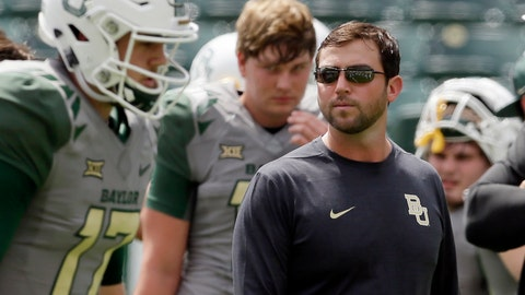 <p>               FILE - In this Sept. 10, 2016, file photo, Baylor offensive coordinator Kendal Briles, right, watches players warm up before an NCAA college football game against SMU in Waco, Texas. Coach Willie Taggart drew some scrutiny for hiring Briles, who worked for his father, Art, at Baylor as that school went through a bruising scandal tied to sexual assault accusations. He will have to work around a deficient offensive line, but if the offense clicks then Taggart's second year in Tallahassee should be much better than his first. (AP Photo/LM Otero, File)             </p>