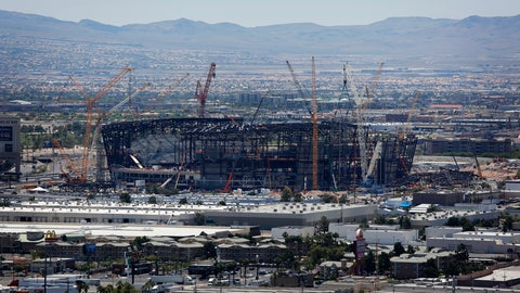 <p>               FILE - In this June 4, 2019, file photo, construction cranes surround the football stadium under construction in Las Vegas. The $1.9 billion stadium being built in Las Vegas for the relocated NFL Raiders team is being named for Allegiant Travel Co. Officials made the announcement Monday, Aug. 5, 2019, during a ceremony marking installation of the final steel beam for the roof of the 65,000-seat indoor stadium just off the Las Vegas Strip. (AP Photo/John Locher, File)             </p>
