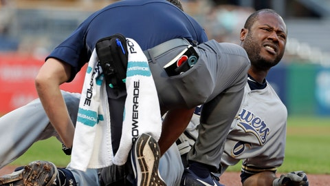<p>               Milwaukee Brewers' Lorenzo Cain, right, is grimaces as he is checked by a team trainer after fouling a ball off his leg while batting during the first inning of the team's baseball game against the Pittsburgh Pirates in Pittsburgh, Tuesday, Aug. 6, 2019. Cain finished the at-bat and left the game. (AP Photo/Gene J. Puskar)             </p>