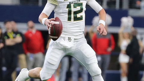 <p>               FILE - In this Nov. 24, 2018, file photo, Baylor quarterback Charlie Brewer scrambles out of the pocket before throwing a pass in the first half of an NCAA college football game against Texas Tech in Arlington, Texas. (Jerry Larson/Waco Tribune-Herald via AP, file)             </p>