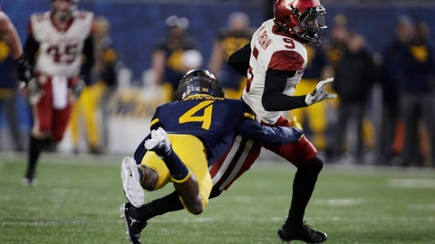 <p>               FILE - This Friday Nov. 24, 2018, file photo shows Oklahoma wide receiver Marquise Brown (5) being tackled by West Virginia safety Josh Norwood (4) during the second half of an NCAA college football game in Morgantown, W.Va. (AP Photo/Raymond Thompson)             </p>