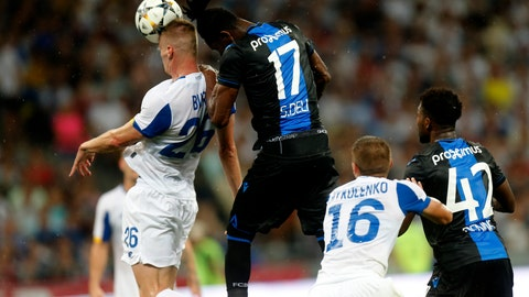 <p>               Brugge's Simon Deli, center, and Dynamo Kiev's Mykyta Burda head the balll during the Champions League third qualifying round, second leg, soccer match between Dynamo Kyiv and Club Brugge at the Olympiyskiy stadium in Kiev, Ukraine, Tuesday, Aug. 13, 2019. (AP Photo/Efrem Lukatsky)             </p>
