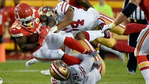 <p>               Kansas City Chiefs running back Darwin Thompson (25) is tackled by San Francisco 49ers linebacker Fred Warner (54) and defensive end Arik Armstead (91), during the first half of an NFL preseason football game in Kansas City, Mo., Saturday, Aug. 24, 2019. (AP Photo/Ed Zurga)             </p>