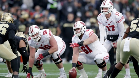 <p>               FILE - In this Nov. 17, 2018, file photo, Wisconsin's Tyler Biadasz (61) gestures as he prepares to snap the ball to quarterback Jack Coan during the first half against Purdue in an NCAA college football game in West Lafayette, Ind. Returning starting center  Biadasz, who underwent hip surgery during the offseason, will anchor the line after earning first-team All-Big Ten honors in 2018. (AP Photo/Michael Conroy, File)             </p>