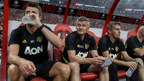 <p>               Manchester United's manager Ole Gunnar Solksjaer, centre looks on prior to the start of the International Champions Cup soccer match between Manchester United and Milan in Singapore, Saturday, July 20, 2019. (AP Photo/Danial Hakim)             </p>