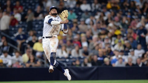 <p>               FILE - In this Aug. 8, 2019, file photo, San Diego Padres shortstop Fernando Tatis Jr. throws to first base late on a single by Colorado Rockies' Yonathan Daza during the sixth inning of a baseball game, in San Diego. Padres rookie shortstop Fernando Tatis Jr. has become one of major league baseball's most exciting young players, showing an instinct and aggressiveness that make it hard to believe he's only 20. (AP Photo/Orlando Ramirez, File)             </p>