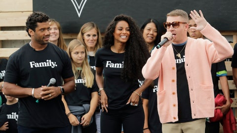 <p>               Seattle Seahawks NFL football quarterback Russell Wilson, left, and his wife, pop singer Ciara, center, listen as hip-hop artist Macklemore, right, speaks Monday, Aug. 19, 2019, during an event in Seattle held to introduce themselves and others as new members of the MLS soccer Seattle Sounders team's ownership group. (AP Photo/Ted S. Warren)             </p>