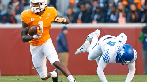 <p>               FILE - In this Nov. 10, 2018, file photo, Tennessee wide receiver Marquez Callaway (1) escapes from Kentucky linebacker Jamin Davis (44) in the first half of an NCAA college football game in Knoxville, Tenn. Tennessee's wide receivers savor the opportunity to play for their new position coach because they appreciate what Tee Martin accomplished during his own playing career. Martin was the starting quarterback on Tennessee's 1998 national championship team and is back at his alma mater trying to help the Volunteers become competitive again in the Southeastern Conference. (AP Photo/Wade Payne, File)             </p>