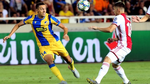 <p>               Ajax's Razvan Marin, right, challenges for the ball with APOEL's Uros Matic during the Champions League qualifying play-off first leg soccer match between APOEL Nicosia and AFC Ajax at GSP stadium in Nicosia, Cyprus, Tuesday, Aug. 20, 2019.(AP Photo/Philippos Christou)             </p>