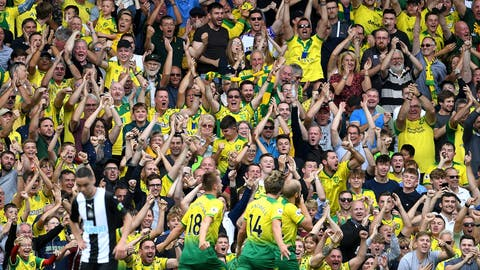 <p>               Norwich City's Teemu Pukki celebrates scoring his side's first goal of the game with fans,  during the English Premier League soccer match between Norwich City and Newcastle United, at Carrow Road, in Norwich, England, Saturday, Aug.17, 2019. (Joe Giddens/PA via AP)             </p>