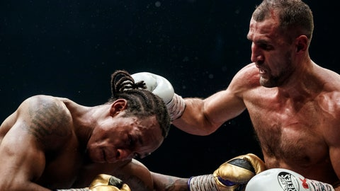 <p>               Boxers Anthony Yarde of Britain, left, and Sergey Kovalev of Russia exchange blows during their WBO light heavyweight title bout in Chelyabinsk, Russia, Saturday, Aug. 24, 2109. (AP Photo/Anton Basanayev)             </p>