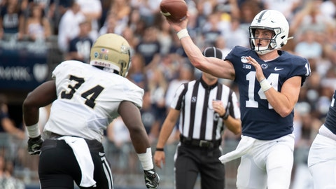 <p>               Penn State quarterback Sean Clifford (14) passes over Idaho linebacker Leo Tamba (34) during the 2nd quarter of an NCAA college football game in State College, Pa., on Saturday, Aug. 31, 2019. (AP Photo/Barry Reeger)             </p>