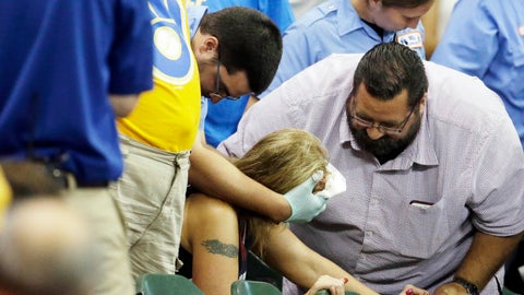 """<p>               FILE - In this July 6, 2015, file photo, a fan is helped after being hit by a foul ball during the ninth inning of a baseball game between the Milwaukee Brewers and the Atlanta Braves in Milwaukee. Illinois' two senators have urged Major League Baseball to be more transparent about fans who are injured by foul balls, saying the lack of data is creating confusion about the extent of the problem. Democratic Sens. Dick Durbin and Tammy Duckworth said in a letter to baseball Commissioner Rob Manfred this week that MLB should """"collect and report data about fan injuries."""" (AP Photo/Morry Gash, File)             </p>"""