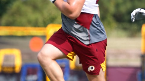 <p>               Washington Redskins offensive guard Wes Martin (78) does a warm up drill during the Washington Redskins NFL football training camp in Richmond, Va., Wednesday, July 31, 2019. Redskins rookie guard Wes Martin isn't just a strong NFL prospect who built his strength growing up on a dairy farm. He started a dog rescue foundation and raised money for it at his pre-draft pro day. (AP Photo/Steve Helber)             </p>