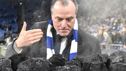 <p>               FILE-In this Dec. 19, 2018 file photo Schalke boss Clemens Toennies smells steaming coal on a trolley beside the pitch prior the Bundesliga soccer match between FC Schalke 04 and Bayer Leverkusen in Gelsenkirchen, Germany. Schalke chairman Clemens Tönnies has resisted calls to resign and will instead step down for three months over comments he made last week that were widely condemned as racist. (AP Photo/Martin Meissner)             </p>