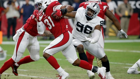 <p>               FILE - In this Aug. 15, 2019, file photo, Arizona Cardinals running back David Johnson (31) runs as Oakland Raiders defensive end Clelin Ferrell (96) defends during the first half of an an NFL preseason football game in Glendale, Ariz. The biggest issue last year in Oakland was the lack of a pass rush. The Raiders finished with just 13 sacks, 17 fewer than the second worst team. No. 4 overall pick Ferrell should help improve the rush a bit although much of his strength comes from his play against the run. Arden Key showed flashes as a rookie and could be more effective as a rusher in a more situational role and the interior rush should be improved with Maurice Hurst in his second year. (AP Photo/Rick Scuteri, File)             </p>