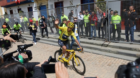 <p>               Tour de France winner Egan Bernal waves to the crowd as he is welcomed home to Zipaquira, Colombia, Wednesday, Aug. 7, 2019. Bernal rode into the town's central square on his bike on wearing the Tour de France's iconic yellow jersey. A group of some 3,000 supporters dressed in the same color chanted his name. (AP Photo/Ivan Valencia)             </p>