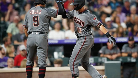 <p>               Arizona Diamondbacks' Josh Rojas, left, celebrates with Nick Ahmed as he crosses home plate after hitting a two-run home run off Colorado Rockies relief pitcher Jake McGee in the sixth inning of a baseball game, Monday, Aug. 12, 2019, in Denver. (AP Photo/David Zalubowski)             </p>