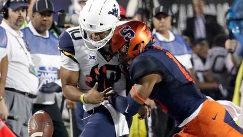 <p>               FILE - In this Dec. 28, 2018, file photo, Syracuse defensive back Andre Cisco, right, breaks up a pass intended for West Virginia quarterback Trey Lowe III (10) during the first half of the Camping World Bowl NCAA college football game in Orlando, Fla. Here's a switch for Syracuse coach Dino Babers _ defense rules. Known for his uptempo offenses, the fourth-year coach is looking to his defense to help lift the No. 22 Orange to even greater heights this fall. (AP Photo/John Raoux, File)             </p>