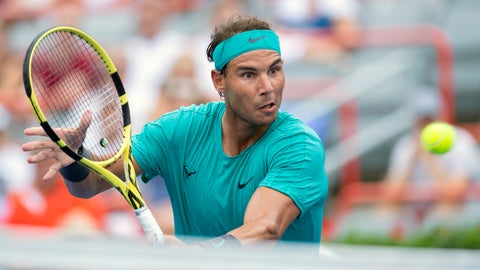 <p>               Rafael Nadal of Spain goes up to the net to return to Daniel Evans of Britain during the Rogers Cup men's tennis tournament Wednesday, Aug. 7, 2019, in Montreal. (Paul Chiasson/The Canadian Press via AP)             </p>